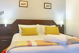 Orange Inn - Our comfortable king-sized beds