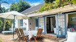 Hout Bay Beach Cottage - Patio with outdoor furniture to relax and enjoy pool and garden