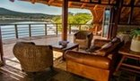 Buffelsdrift Game Lodge - Lounge overlooking the Waterhole