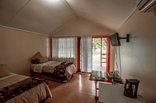 Simunye Country Club - Wooden Bungalow Bedroom