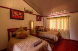 Simunye Country Club - Log cabin bedroom