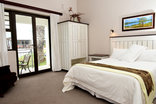 Riviera Hotel Velddrif - Double bedroom with private patio.