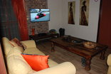 Simcha Lodge - The TV lounge upstairs with DSTV available.
