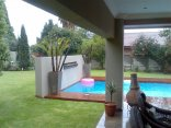 At Olive Guesthouse - Swimming pool and patio