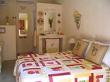 CocoCabana Guest House - Red & Yellow Room