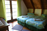 Nectar Cottage - Green bedroom