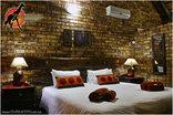 a Zaganaga Kruger Lodge - King size bedroom