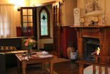 Hawklee Country House - The main hub of the house by the fire place and TV