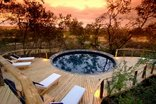 Nambiti Plains Private Game Lodge - Pool area at dusk