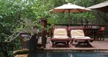 Tanamera Lodge - Lounging on the main deck by the pool