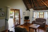 Coral Tree Cottages - One bedrom cottage - lounge