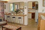 Fairhaven Guest Accommodation - Open-plan kitchen and lounge area