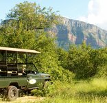 Shikwari Game Reserve - Game Vehicle and view of mountains