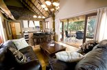 Caracal Lodge - Kudu lounge and kitchen and Patio