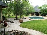 Shikwari Game Reserve - View of Pangolin Rondavels & Pool
