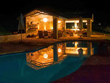 Madi a Thavha Mountain Lodge - Pool and lapa by night