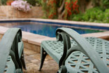 Petit Plaisir Self Catering Cottage - chairs at the pool