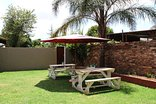 Glen Rest Country Lodge - An option to have breakfast out in the gardens
