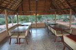 Magorgor Safari Lodge - Dining area under big thatched roof