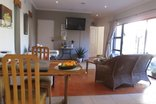 Vue Grande Self Catering Accommodation - Queen Lounge with big screen TV