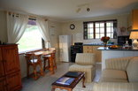Enchanted Garden Guest Chalet and Cottage - Cottage open plan kitchen/lounge