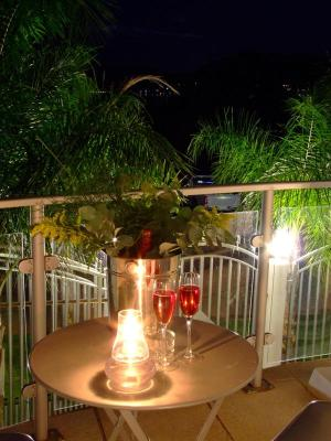 Champagne with Candlelight on the Communal front balcony or Gazebo