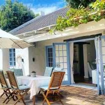 Patio with outdoor furniture to relax and enjoy pool and garden
