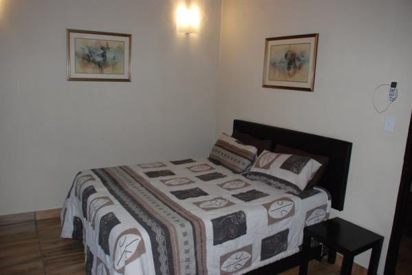 One of the Bedrooms with a Queen Size Bed